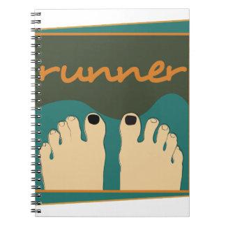 Dedos del pie del corredor cuaderno