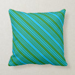 [ Thumbnail: Deep Sky Blue & Forest Green Colored Pattern Throw Pillow ]