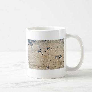 Deep traces of a large dog on the sand coffee mug