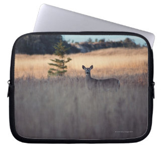 Deer in field of tall grass laptop sleeve