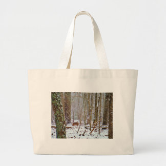 Deer in the snow licking leg canvas bag