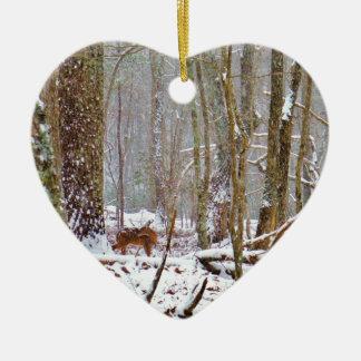 Deer in the snow, licking leg ceramic ornament