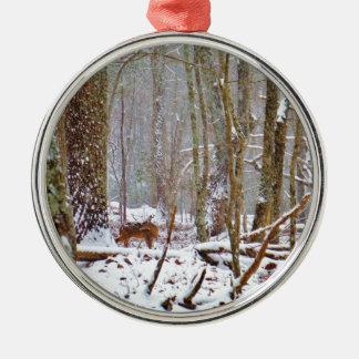 Deer in the snow, licking leg metal ornament