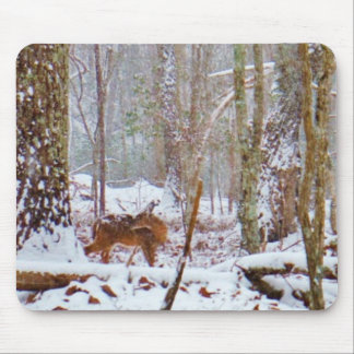 Deer in the snow, licking leg mouse pad