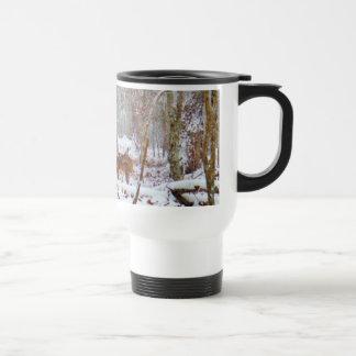 Deer in the snow, licking leg travel mug