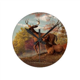 Deer on an Autumn Lakeshore Round Wall Clocks