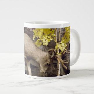 Deer rubbing antlers cup