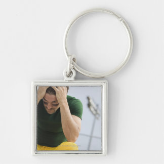 Defeated Football Player with Head in Hands Keychains