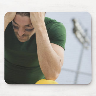 Defeated Football Player with Head in Hands Mouse Pad