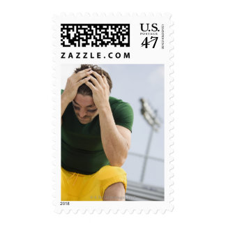 Defeated Football Player with Head in Hands Postage
