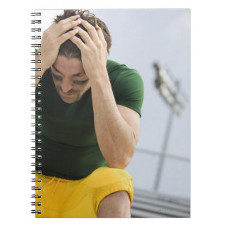 Defeated Football Player with Head in Hands Spiral Notebook
