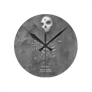 Defiance Clock, dug-up skeleton, skull at 12:00 Round Clock