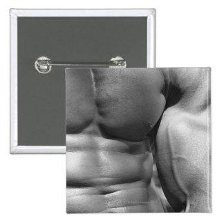 Defined abdomen and bicep button