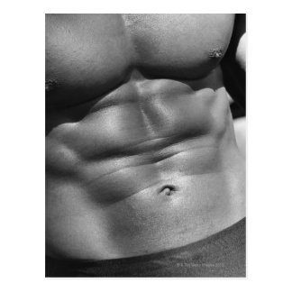 Defined abdomen of bodybuilder postcard