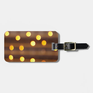 Defocused and blur image of yellow round light bul luggage tag