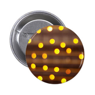 Defocused and blur image of yellow round light bul pinback button