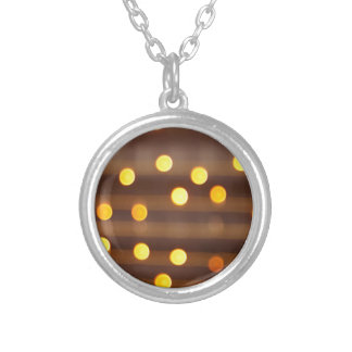 Defocused and blur image of yellow round light bul round pendant necklace