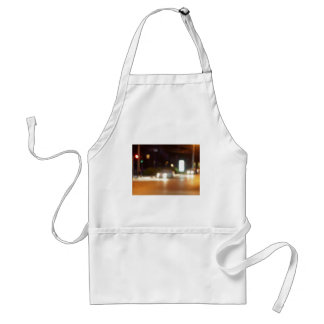 Defocused car and the lights from the headlights adult apron