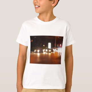 Defocused cars, the lights from the headlights T-Shirt
