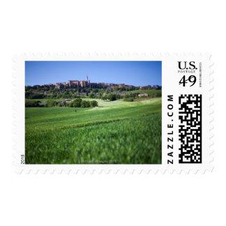 defocused grainfield with on pienza, tuscany, postage