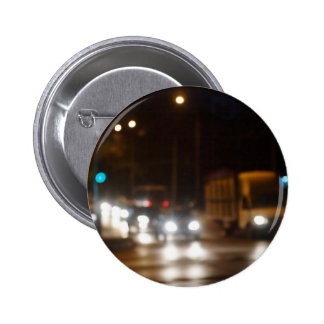 Defocused image of night traffic on city street 2 inch round button