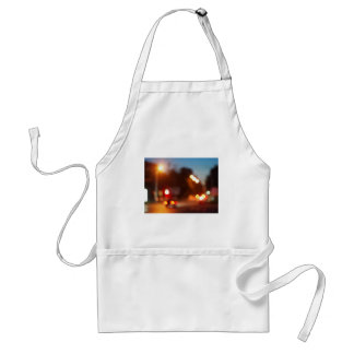 Defocused lights from the headlights and tail ligh adult apron