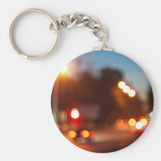Defocused lights from the headlights and tail ligh basic round button keychain