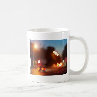 Defocused lights from the headlights and tail ligh coffee mug