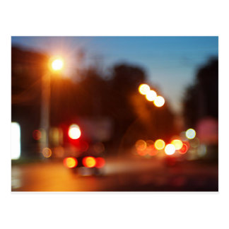 Defocused lights from the headlights and tail ligh postcard
