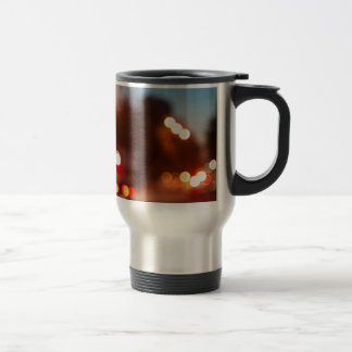 Defocused lights from the headlights and tail ligh travel mug