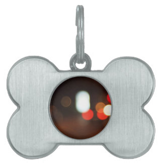 Defocused lights from the headlights pet ID tag