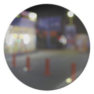 Defocused night urban scene with blurred lights melamine plate