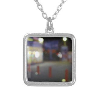 Defocused night urban scene with blurred lights square pendant necklace