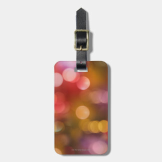 Defocused red and orange fairy lights luggage tag