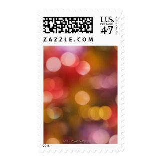 Defocused red and orange fairy lights postage