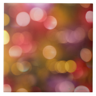Defocused red and orange fairy lights tile