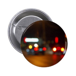 Defocused red and yellow lights on the night the t 2 inch round button