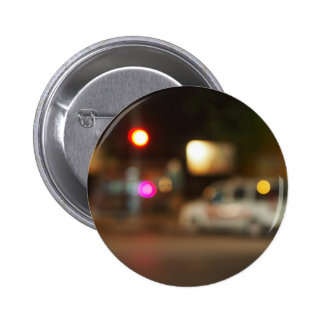 Defocused silhouette of the car and traffic lights 2 inch round button
