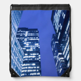 Defocused upward view of office building windows drawstring bag