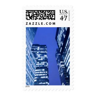 Defocused upward view of office building windows postage