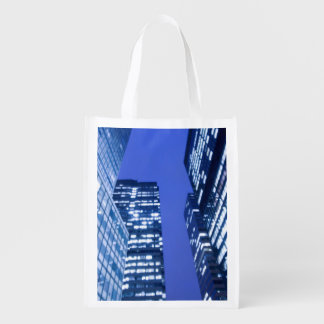 Defocused upward view of office building windows reusable grocery bag