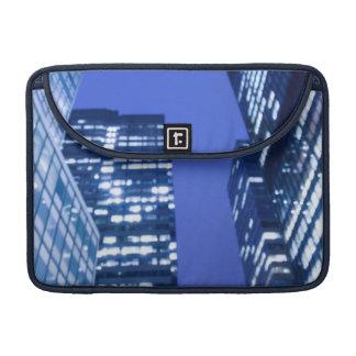 Defocused upward view of office building windows sleeves for MacBook pro