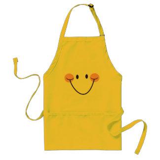 Delantal amarillo sonriente feliz de la cocina