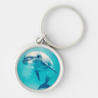 Delfín de Bottlenosed subacuático Llavero Redondo Plateado