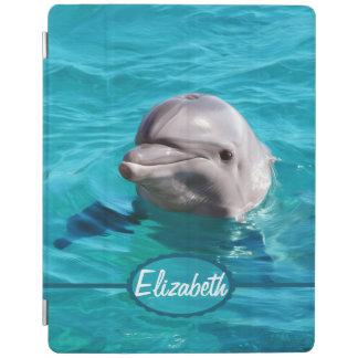 Delfín en foto del agua azul cubierta de iPad