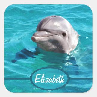 Delfín en foto del agua azul pegatina cuadrada