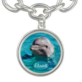 Delfín en foto del agua azul pulsera