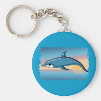 Delfín en la salida del sol llavero