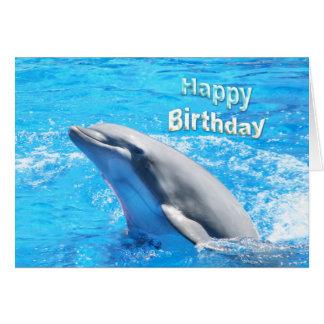 Delfín en tarjeta del feliz cumpleaños del agua