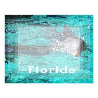 delfín que sale del agua clara florida.jpg del tru plantillas de membrete